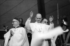 Pope Paul VI giving blessing.