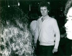 """Man in a disco and looking at the camera.  """"Disco ___ """""""