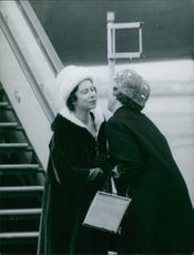 TWO LADY MEETS IN AIRPORT
