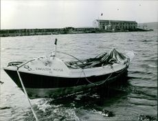 A boat being pulled by rope on the coast.