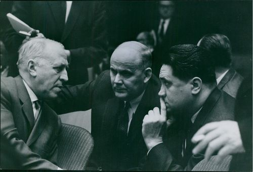 Valerian Alexandrovich Zorin talking with two man.