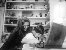 Claudia Cardinale with a child.