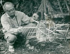 A journalist checking a ambushed flying trap during Vietnam War