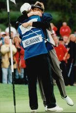 Lotta Neuman is congratulated by his caddy after winning the Trygg Hansa Ladies Open.