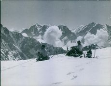 Two mountaineers relaxing on the top.