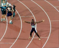Michael Johnson after winning both 200 and 400 meters in the Olympic Games