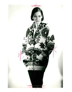 Fashion and wool hand knitted aztec pattern cardigan .