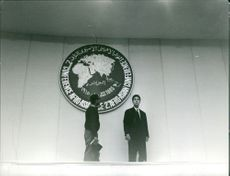 Ahmed Ben Bella standing with a man during Afro-Asian Conference.  Taken - 22 June 1965
