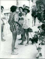 Princess Soraya talking to a lady.