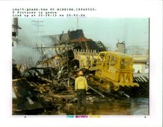 The 1994 Northridge earthquake USA:a demolition crew knock down the remains.