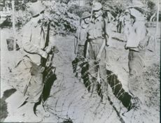 German prisoners seen talking to the American and British guards.