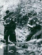 Soldiers trailing down the stream. Vietnam.