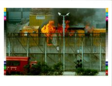 Fire comes from a frieght container used as an office inside high island detention center in hong kong.