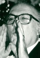 """Portrait image of Frederico Fellini taken in connection with the premiere of his film """"Intervista""""."""