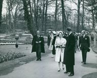 Queen Juliana of the Netherlands walking with other delegates.