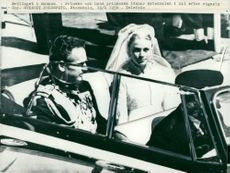 Prince Rainier and his princess leave the cathedral by car after the wedding