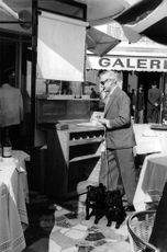 Duke of Windsor with his dog at a store.