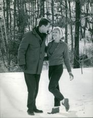 A couple looking into each others eyes during winter.