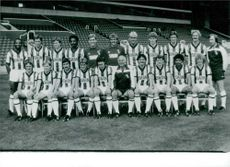 The English football team members including physiotherapist Richard Roberts and Manager Ron Wylie.