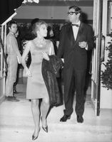 Roger Vadim and Jane Fonda coming from an event.