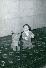 A childhood image of Crown Prince of Iran Reza Pahlavi son of former Shah of Iran Mohammad Reza Pahlavi while he playing with a toy and smiling