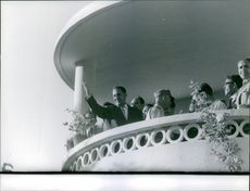 Ferhat Abbas is waiving from their balcony. 1962