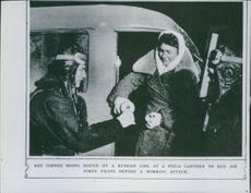 Hot coffee being issued by a Russian girl at a field canteen to Red Air Force pilots before a bombing attack.
