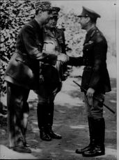 General de Gaulle, King George VI welcomes the French practice camp