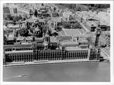 A black and white exterior image taken from the top of the English Parliament in London.