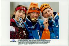 The medals in the 5000 m speed skating Bart Veldkamp (bronze), Gianni Romme (gold) and Rintje Risma (silver) bite in their medals during the Winter Olympics 1998