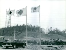 Three flags erected beside each other during Japan Expo 1970.