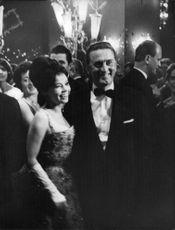 Pascale Petit with Kirk Douglas, smiling, at an event.