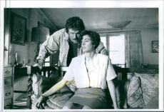 Sean Young and Patrick Bergin talking to each other during a scene in film Love Crimes.  1992