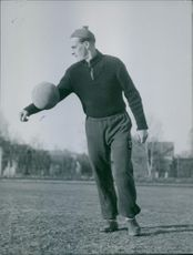 A football player is practicing before the game. 1944