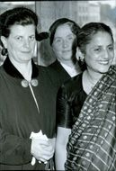Mme Leroy-Boy, Belgium and Mrs. Kamala Dhingra, India, Painting Anna Küntzel in the background