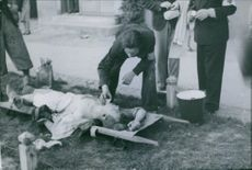 Polish medics attend to a civilian who was severely injured, 1939.