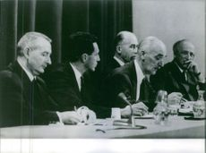 A photo of men in a meting