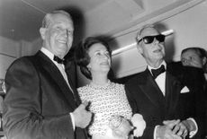 The Duke and Duchess of Windsor posing for a photo ops with a gentleman