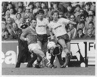 Garry Parker and Peter Reid are fighting for the ball