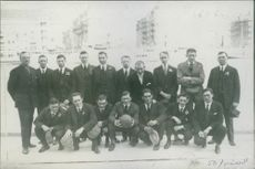 American footballers gathered and posing for photographs. 1916