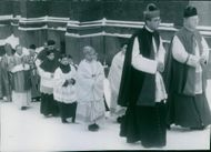 The procession of choir boys and attendant priests in the lead and the bishop last when John Erik Müller's silver anniversary as a Catholic bishop in Sweden. - 12 January 1948