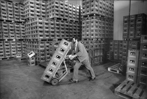 A warehouse worker moves a few slopes with the beer Sturmbier aus Straubing