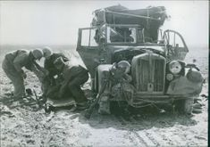 American ambulance drivers in Tunisia remove the body of the Italian driver in the vehicle, 1943.