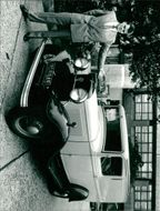 Auctioneer Christopher Beckett with the former Evening News delivery van.