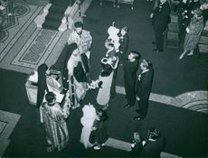 Aerial view of John Spencer-Churchill with his wife during an event.