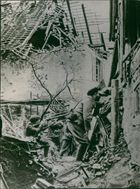 Soldiers hidden at the damaged place and attacking at the enemy during First World  War, 1916.