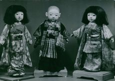 Three dolls.
