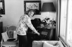 Princess Irene of the Netherlands, touching on the stereo, smiling while looking at the camera, 1964.