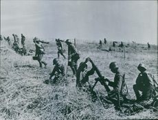 Infantry goes with grenades and over. The infantry is the Bulgarians. 1940