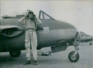 A pilot standing beside of the fighter jet after landing